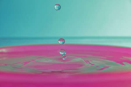 several water spheres floating after bouncing