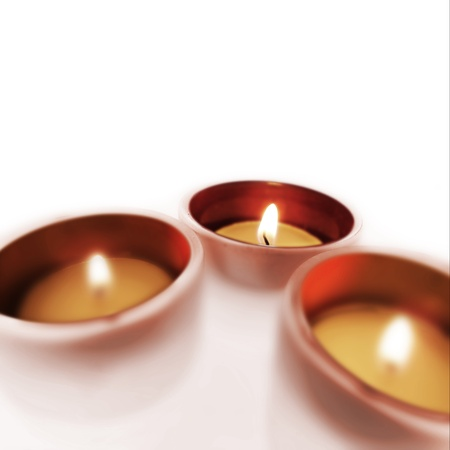 Three carry-you guard of crystal with ignited candles  Stock Photo - 13343704