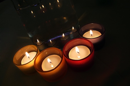 ignited: Cuatro porta-velas de cristal con velas encendidas. Four carry-you guard of crystal with ignited candles.