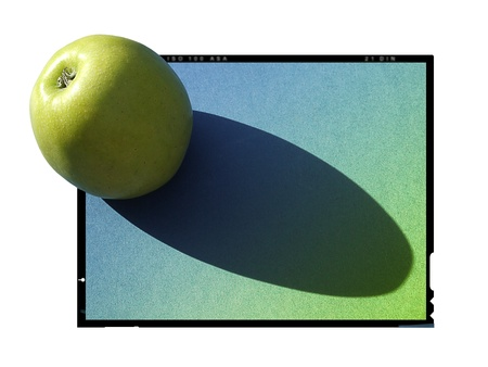 Apple on a porcelain plate