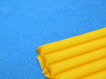Yellow mat on the water in the pool