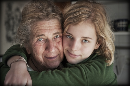 two generation family: Portrait of happy grandmother with her granddaughter