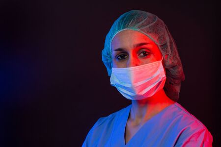 Nurse wearing respirator mask holding a blood test for the new Coronavirus, covid-19. Coronavirus Pandemic Concept.