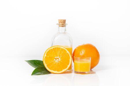 Orange and orange slice with orange juice and orange leaf isolated on white background. Stok Fotoğraf