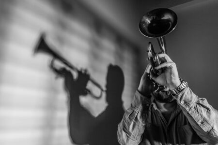 shadow of a jazz musician playing trumpet. Jazz music concept.