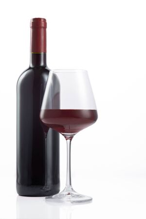 Bottle and glass of Spanish red wine on white background