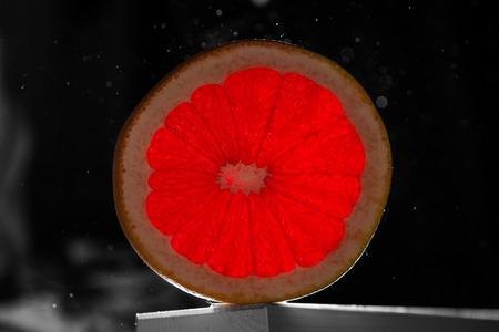 vacuole: grapefruit on a black background