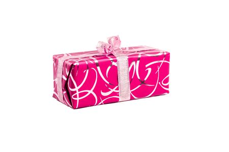 packaged rectangular gift in pink packaging with gold bow and gold pattern on a white background