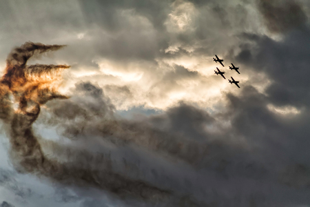 Four airplanes formation on a sunset sky at an air show