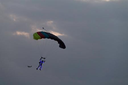 Parachutist at an air show with lights