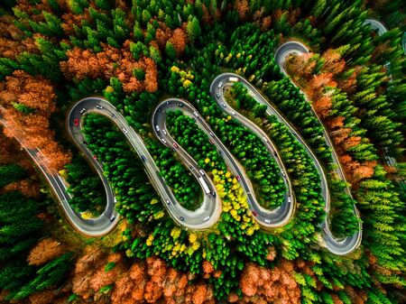 Beautiful aerial view of a curvy winding road with serpentine and colorful autumn trees, Cheia, DN1A, Romania