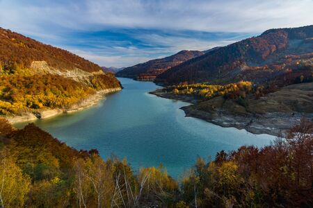 Beautiful autumn landscape with golden colored trees on the shores of Siriu lake, Siriu Dam, Buzau River