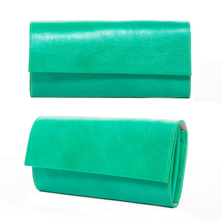 women accessories on white background, green leather wallet photo