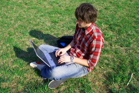 test deadline: Casual guy with laptop Stock Photo