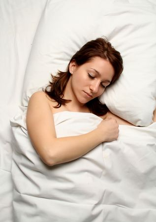 Close-up of a beautiful girl sleeping covered Stock Photo