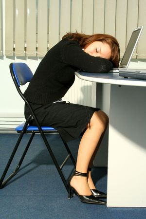 working overtime: Businesswoman sleeping on the laptop