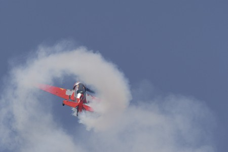 coanda: BUCHAREST, ROMANIA - JULY 17: Acrobatic airplanes perform during the airshow on July 17, 2010 on Henri Coanda airport, Bucharest, Romania.