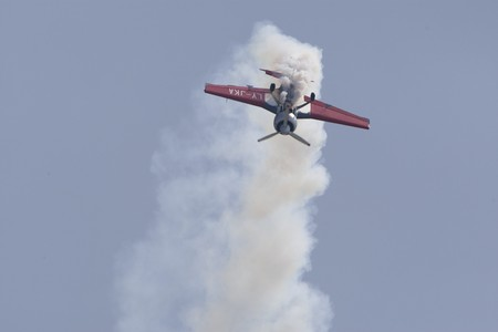 henri coanda: BUCHAREST, ROMANIA - JULY 17: Acrobatic airplanes perform during the airshow on July 17, 2010 on Henri Coanda airport, Bucharest, Romania.