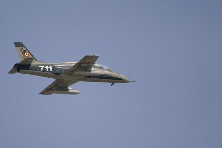 coanda: BUCHAREST, ROMANIA - JULY 17: Jet Fighters perform during the airshow on July 17, 2010 on Henri Coanda airport, Bucharest, Romania.