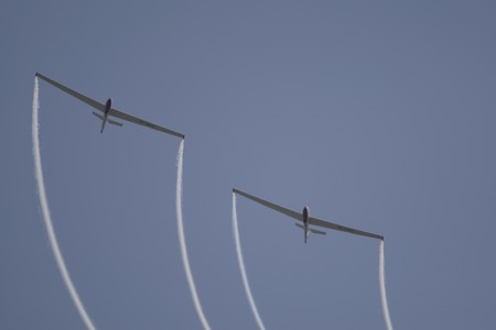 henri coanda: BUCHAREST, ROMANIA - JULY 17: Acrobatic gliders perform during the airshow on July 17, 2010 on Henri Coanda airport, Bucharest, Romania.