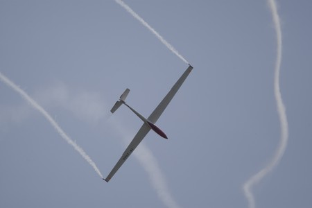 coanda: BUCHAREST, ROMANIA - JULY 17: Acrobatic gliders perform during the airshow on July 17, 2010 on Henri Coanda airport, Bucharest, Romania.