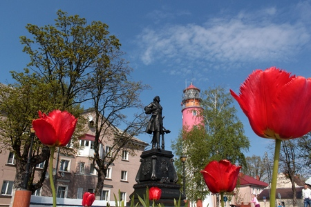 Monument to Peter the Great in Russia, the Baltic, on the background of flowers