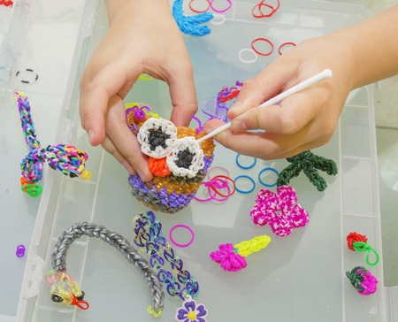 Rainbow loom- Colored rubber bands for weaving accessories Stock Photo