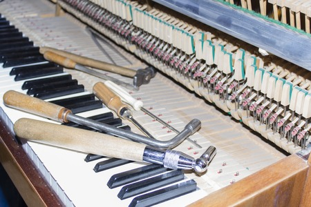 acoustically: Detailed view of Upright Piano during a tuning