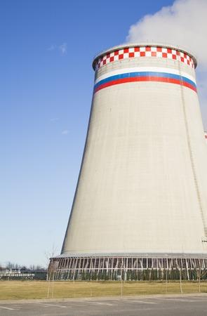 Large factory chimneys on blue sky background. Stock Photo
