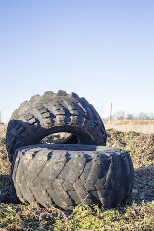 traction: old tire of big tractor,big tractor tire,wheel tractor. Stock Photo