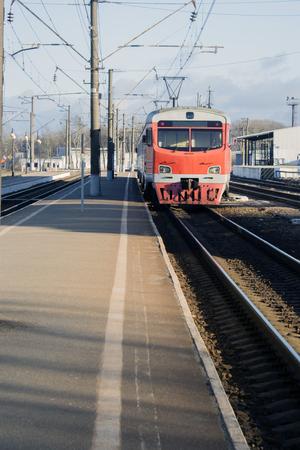 regional: Old passenger train, red. Stands on the platform