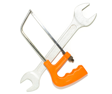 Hacksaw on metal crosses the key on a white background.