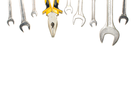 Brilliant keys and pliers on a white background Stock Photo