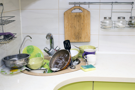 mess: A bunch of dirty dishes in the kitchen. Stock Photo