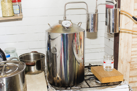 moonshine still in action, at home Stock Photo