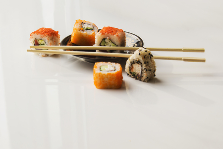 Sushi plate against a white background and chopsticks