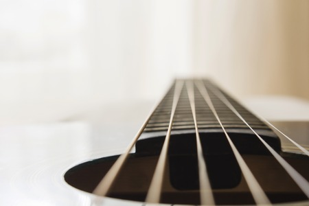 Selective focus, macro lens, shooting retro classic vintage guitar, focus on strings.