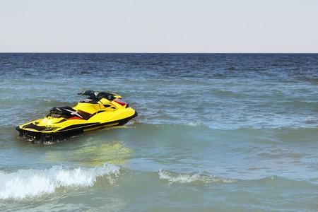 Yellow Jet ski on the beach Stock Photo
