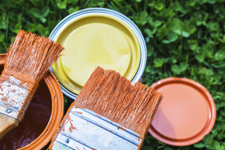 Paint cans, brushes, bright orange color