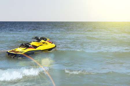 Yellow Jet ski on the beach Imagens