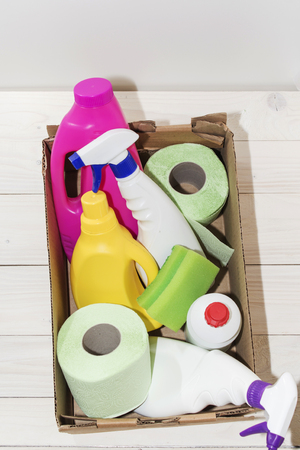 detergents bottles, on wooden background light, close-up Stock Photo