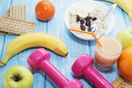 Fruits, vegetables, juice, smoothies and dumbbells health diet and fitness lifestyle concept Stock Photo