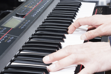 Close-up of a music performers hand playing the piano, mans hand, classical music, keyboard, synthesizer, pianist