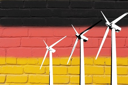Wind turbines on the background of the flag Germany