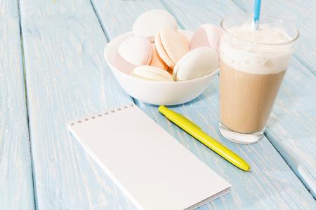 open notebook, white mug with coffee, marshmallows Stock Photo