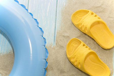 summer vacation on the beach. Yellow flip-flops and swimming laps.