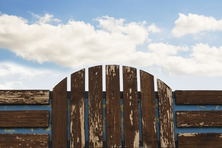 Wooden fence on blue sky background, Billboard. Stock Photo