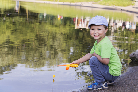 boy fishing on the lake, the concept of sport fishing. Stockfoto