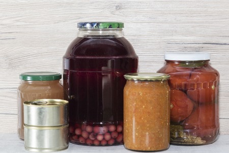 Storage shelves in pantry with homemade canned preserved fruits and vegetables