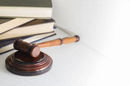 hammer judge on the background of a pile of books, the image on a light background.